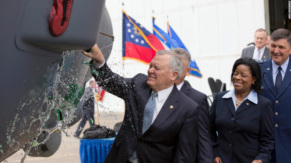 During a christening ceremony, Georgia Gov. Nathan Deal smashes a bottle of Chattahoochee River water across the nose of the MC-130J Super Hercules at the Lockheed Martin factory. Water was used instead of the traditional champagne in honor of former Gov. Marvin Griffin, a teetotaler who used river water to christen the first C-130 to come off the assembly line in 1955.