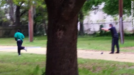 This still, released by the family of Walter Scott, appears to show North Charleston, South Carolina police officer Michael Slager shooting Scott in the back as he ran away from the officer. The incident took place Saturday, April 4, 2015.