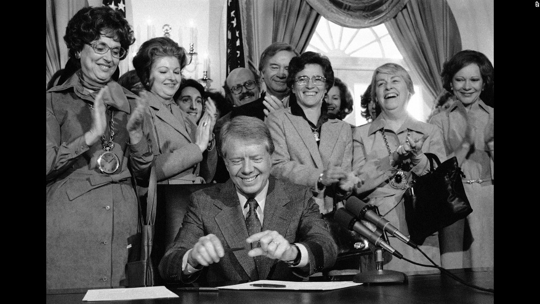 Also in 1978, then-President Jimmy Carter signed legislation extending the original ERA ratification deadline from 1979 to 1982. Among those watching is his wife, Rosalynn, far right. Now 90, Carter says he is devoting the rest of his life to fighting for women's rights at the urging of the former first lady.