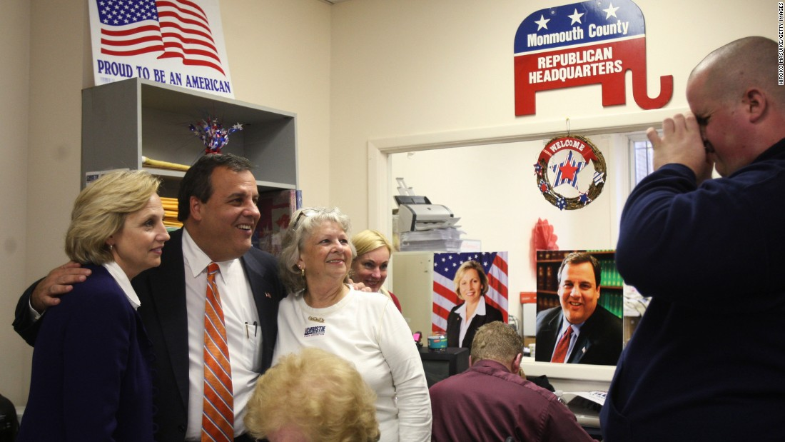 Christie and his running mate, Kim Guadagno, left, pose for photographs after making phone calls to voters at Monmouth County Republican Headquarters in Freehold, New Jersey, on November 2, 2009.