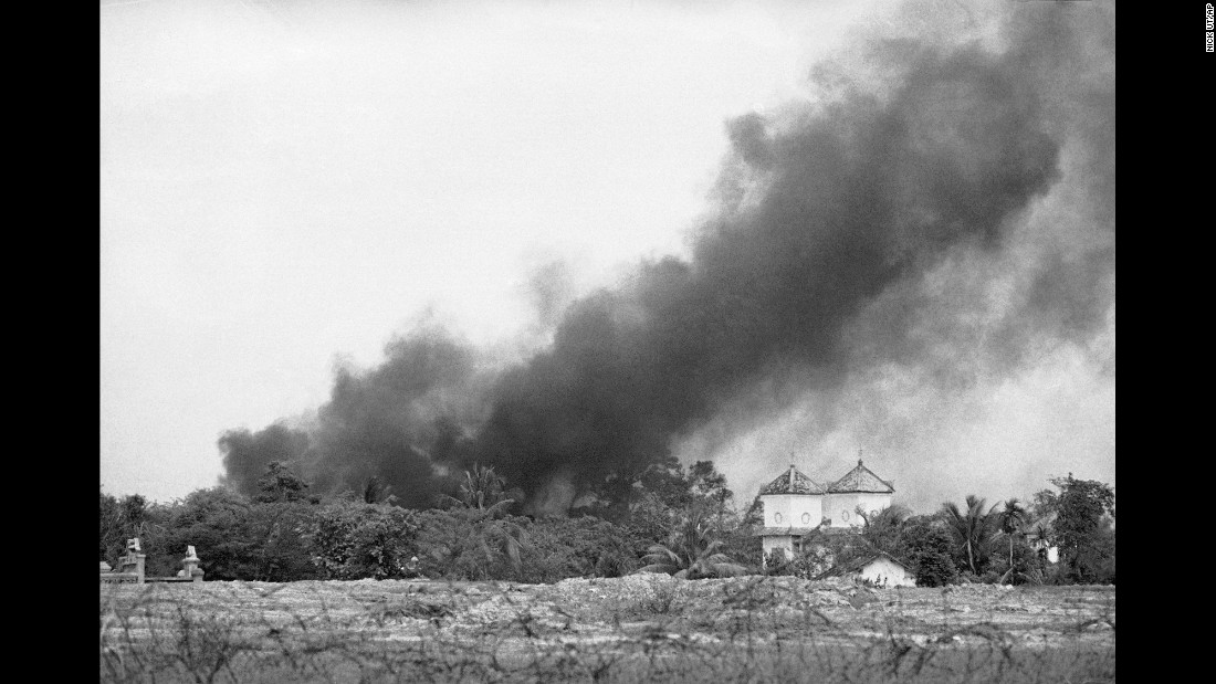 Smoke from a napalm bomb rises over a Trang Bang church.
