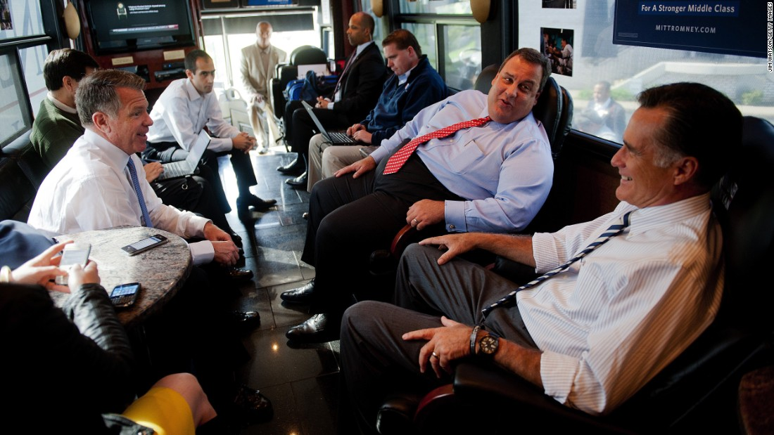Christie and Republican presidential candidate Mitt Romney speak with Romney adviser Bob White on board the Romney campaign bus in Mount Vernon, Ohio, on October 10, 2012.