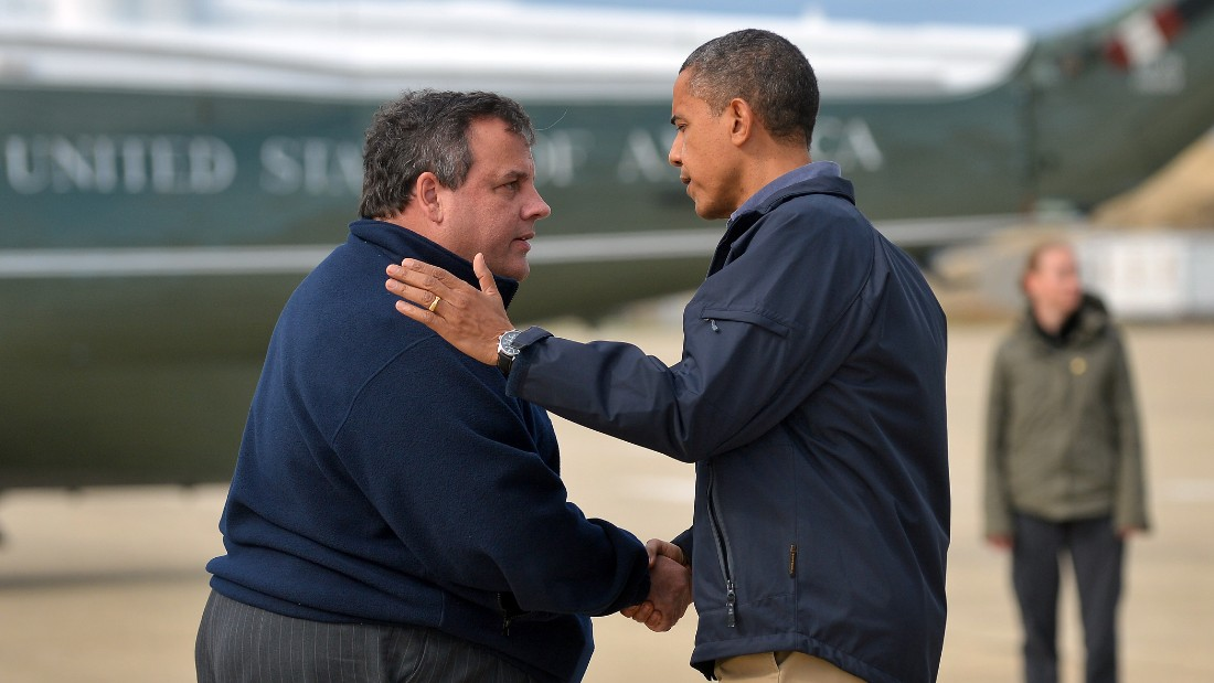 Christie greets President Barack Obama on his arrival in Atlantic City, New Jersey, on October 31, 2012, to visit areas hit by Superstorm Sandy. Christie was later criticized  by some in his party for his warm welcome of Obama.