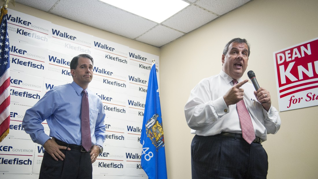 Christie campaigns for Wisconsin Gov. Scott Walker during a campaign stop at the GOP field office in Hudson, Wisconsin, on September 29, 2014.