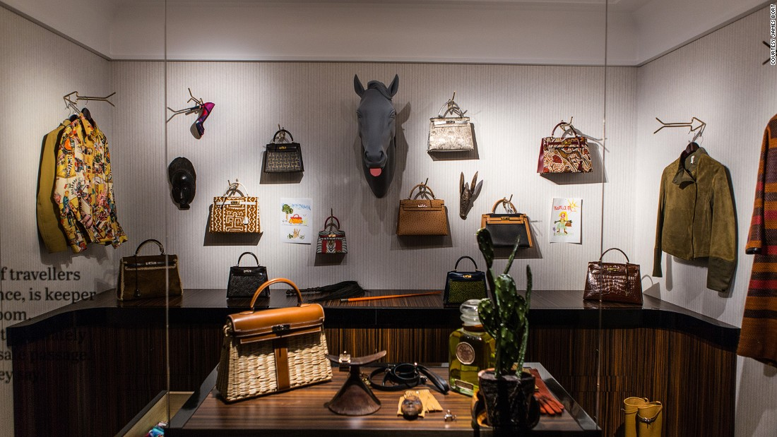 Where would the urban explorer be without her collection of Kelly bags? (The mounted horse head seems to be in on the joke.)
