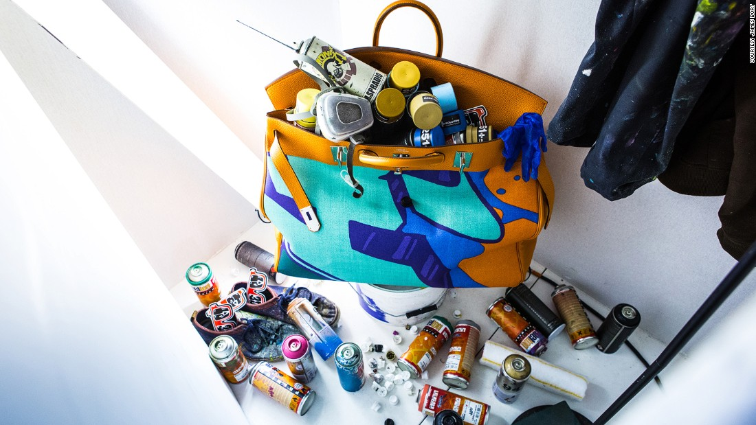 This limited-edition spray-painted Birkin full of old cans is hidden behind one of the panels.