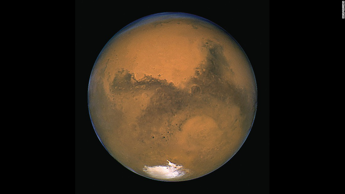 Hubble has given us many images of our neighbor Mars. This image was taken in 2003 when Mars made its closest approach in nearly 60,000 years. On August 27, 2003, the two worlds were only 34.6 million miles apart from center to center. By contrast, Mars can be about 249 million miles away from Earth.