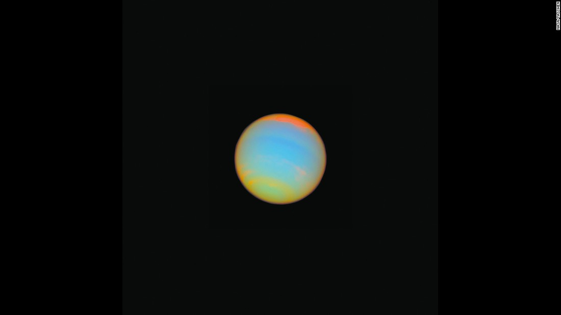 Hubble captured this image of the distant blue-green world Neptune in 2005. Fourteen different colored filters were used to help scientists learn more about Neptune's atmosphere. Neptune is about 2.8 billion miles from Earth.