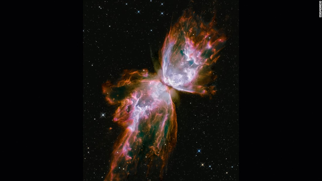 The Bug, or Butterfly Nebula looks like a butterfly with its wings stretching across the galaxy. It's actually a cloud of roiling gas shed by a dying star. Scientists say the gas is more than 36,000 degrees Fahrenheit and is expanding into space at more than 600,000 miles an hour. This image was taken with Hubble's Wide Field Camera 3, a camera installed on Hubble during its May 2009 upgrade by shuttle astronauts. The nebula is about 3,800 light years away in the constellation Scorpius.