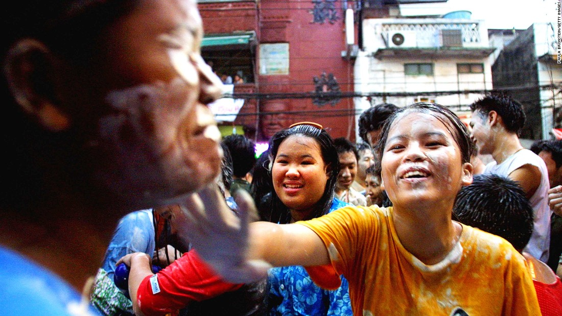 "Allowing someone to apply wet powder to your face is considered a nice way to experience Songkran. The powder stays with you as a little ""blessing,"" even after your clothes have dried."