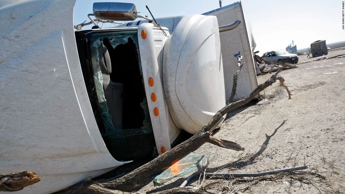 A tractor-trailer lies on its side April 10 in Rochelle, Illinois. It was knocked over while parked the previous night.