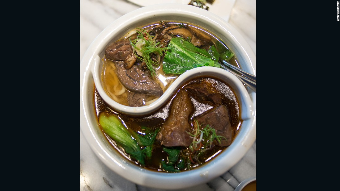 "The unique ""double flavored beef soup,"" with both spicy and clear broths, is served in a yin-yang shaped bowl."