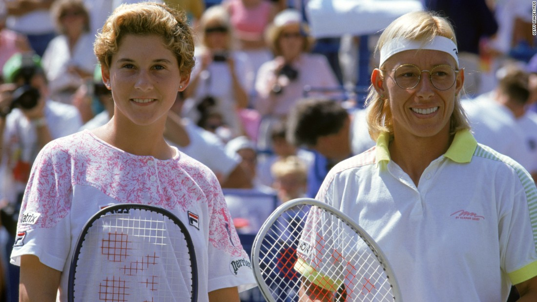 A baby-faced Monica Seles poses with Martina Navratilova after winning the 1991 U.S. Open.