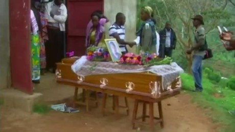 cnni kriel pkg village holds funeral for masscre victim_00022710