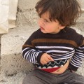 yazidi refugee camp boy scowls