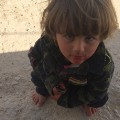 yazidi refugee camp boy looking up