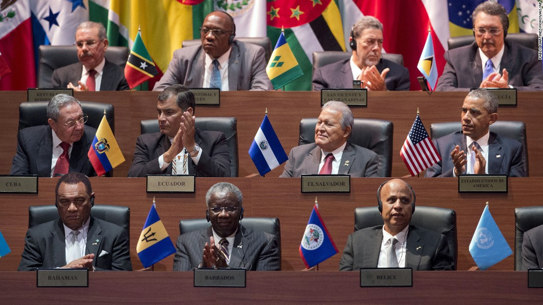 Obama, right middle row, and Castro, left middle row, and other world leaders participate in the Summit of the Americas on April 10.