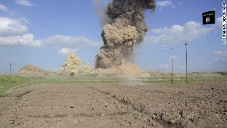 "In this image made from video posted on a militant social media account affiliated with the Islamic State group late Saturday, April 11, 2015, purports to show militants destroying the ancient Iraqi Assyrian city of Nimrud, a site dating back to the 13th century B.C., near the militant-held city of Mosul, Iraq. The destruction at Nimrud, follows other attacks on antiquity carried out by the group now holding a third of Iraq and neighboring Syria in its self-declared caliphate. The attacks have horrified archaeologists and U.N. Secretary-General Ban Ki-moon, who last month called the destruction at Nimrud ""a war crime.""(militant video via AP)"