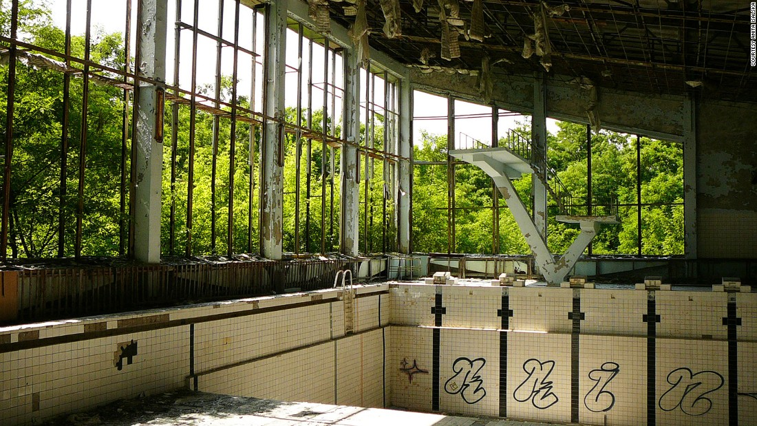 Three decades after the nuclear disaster there, guided tours take increasing numbers of tourists deep into Chernobyl's Exclusion Zone. Pripyat, the town built near the Chernobyl power plant, lies abandoned. This ruined swimming pool stands empty under rotting wooden beams.