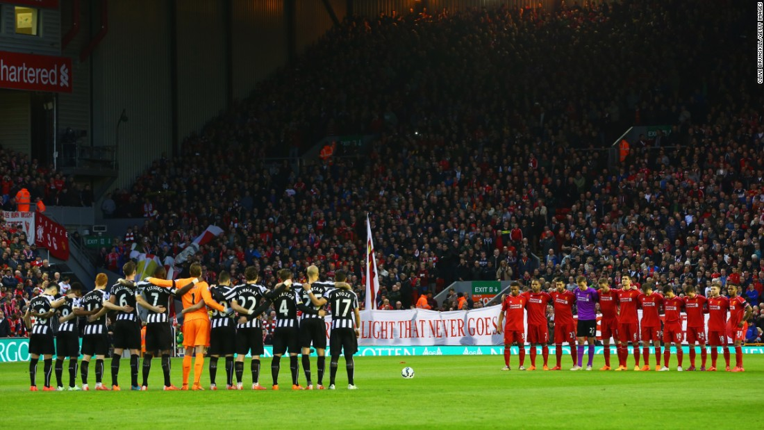 Fans, players and officials mark the Hillsborough anniversary before the Premier League match between Liverpool and Newcastle at Anfield in 2015.