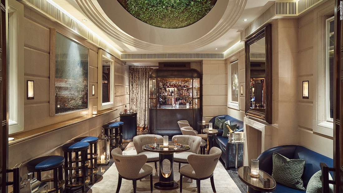 Accessed via a velvet curtain, the tucked-away bar is illuminated by an overhead skylight and has lustrous brass, leather accents and limestone floors.