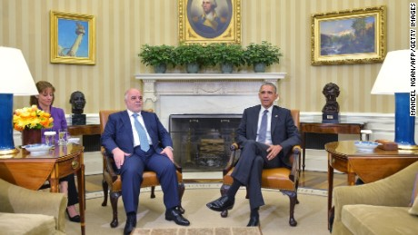 Iraqi Prime Minister Haider al-Abadi (L) and US President Barack Obama await the press corps to set up during a bilateral meeting in the Oval Office on April 14, 2015 in Washington, DC. President Barack Obama met Iraqi Prime Minister Haider al-Abadi in the White House on Tuesday and hailed the progress he said the US-backed Iraqi forces were making against the Islamic State group.