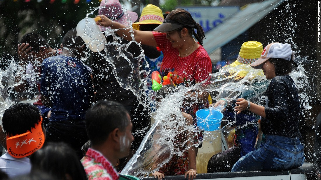 Revelers take part in water fights in Thailand's southern province of Narathiwat on April 13, 2015.