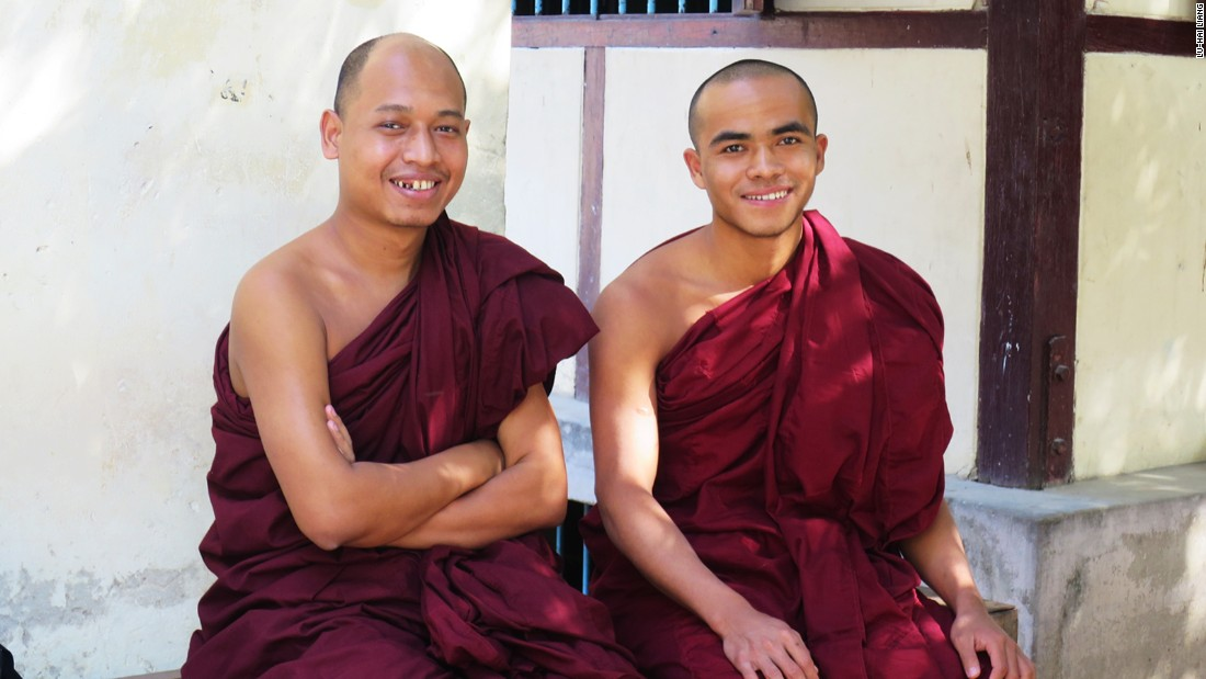 Ashin Pannadhaya (left) and Ashin Zavana (right) hope tourists will respect their lunch hour.