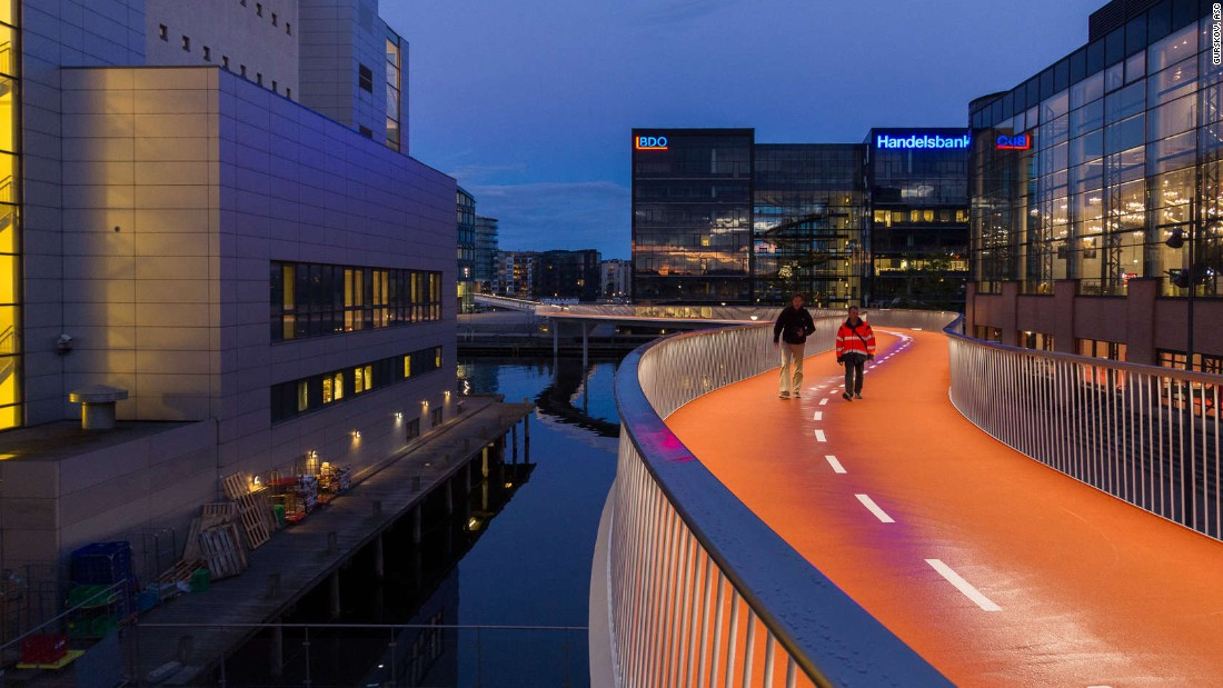 "Dissing+Weitling is the architecture firm behind Copenhagen's cool new ""Bicycle Snake."" The 190-meter-long orange bridge and 30-meter ramp were designed to replace a nearby staircase -- a time-consuming obstacle for the 12,500 cyclists that pass through the area daily."