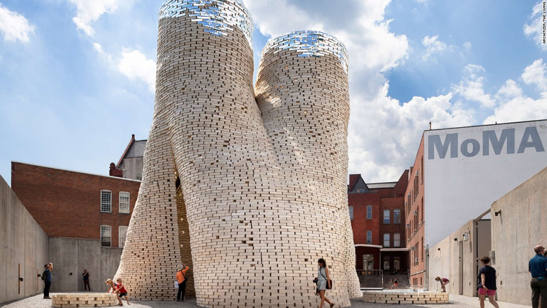 "Design firm By The Living was commissioned by New York's Museum of Modern Art and MoMA PS1 to create this circular tower of organic bricks. ""The structure is an extension of the natural Carbon Cycle, with a revolutionary new construction material that grows out of living materials and returns to the earth through composting at the end of the structure's lifecycle,"" says By The Living."