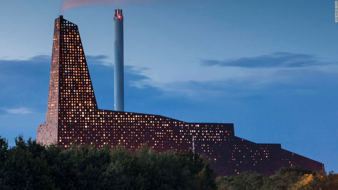 it's not often that an industrial power plant makes you want to grab your camera. The design for this new Incineration Line in Roskilde, by (designed by) Erick van Egeraat, features laser-cut circular openings that cover the raw umber-colored aluminum facade. At night, back lighting turns the incinerator into a glowing beacon, symbolizing the energy production going on inside the facility.