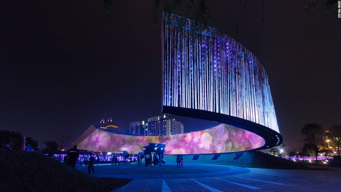 "Built in honor of Taiwan's Lantern Festival by J.J. Pan and Partners, this giant lantern features a ring of moving images produced by projection technology and LED lighting. The choice of form and materials used for the lantern were inspired by the historical and cultural characteristics of Hsinchu, whose ancient name was ""City of Bamboo Walls,"" says the firm."