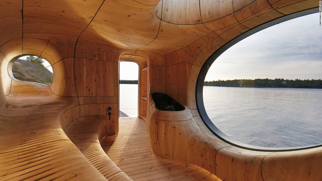 "Perched at the northwest edge of a private island in Ontario, the Grotto Sauna is a sculpted space designed by Partisans. ""Challenging the standards of current practices in the construction industry, we worked directly with a millwork and steel fabrication partner on every detail,"" says the firm. ""Together, we developed a new process of fabrication; utilizing state of the art 3-D technology to scan, model and build the Grotto."""