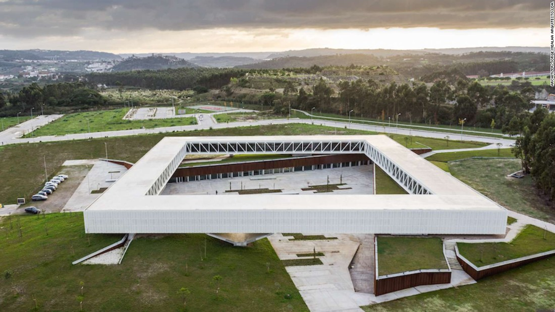 "The Óbidos Technological Park sits between Lisbon and Coimbra. It was designed to link academic research with business production, especially in the field of creative industries. ""The project for the main building defines an inhabited topography on which a square-shaped ring rests,"" says design firm Jorge Mealha Arquitecto."