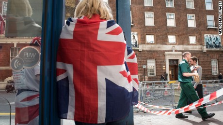 Royal supporters stand outside the Lindo Wing of St Mary's hospital in central London where the Duchess of Cambridge will give birth on April 16, 2015. The world's media started counting down today to the arrival of Britain's royal baby when a press pen was erected outside the hospital where Prince William's wife Kate is due to give birth. AFP PHOTO / LEON NEALLEON NEAL/AFP/Getty Images