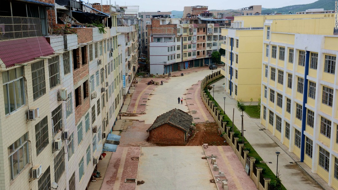 A house lies in the middle of a newly developed road in Nanning, Guangxi province on April 10, 2015. The owner was in a a dispute with the government over its demolition.
