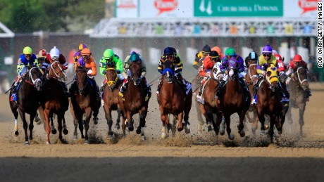 The field comes out of the starter's gate to start the 140th running of the Kentucky Derby at Churchill Downs on May 3, 2014 in Louisville, Kentucky.
