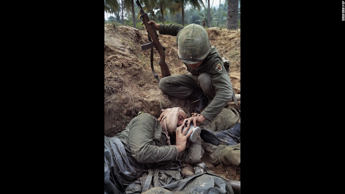Staff Sgt. Harrison Pell, a wounded American soldier, drinks from a comrade's canteen during a January 1966 firefight between U.S. troops and a combined North Vietnamese and Viet Cong force.