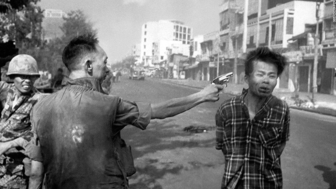 South Vietnamese Gen. Nguyen Ngoc Loan, chief of the National Police, fires his pistol into the head of suspected Viet Cong officer Nguyen Van Lem on a Saigon street on February 1, 1968, early in the Tet Offensive.