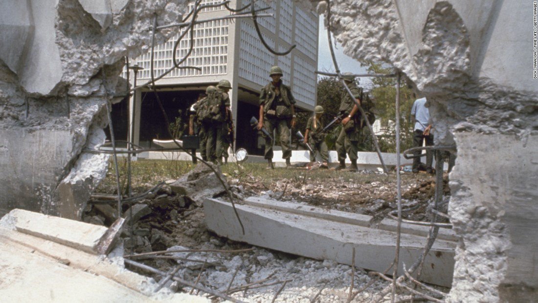 Troops look at the aftermath of an attack on the U.S. Embassy in Saigon in 1968.