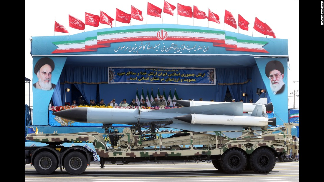 Missiles are paraded past Rouhani and military leaders.