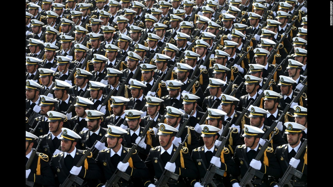 Iranian sailors march in the parade.