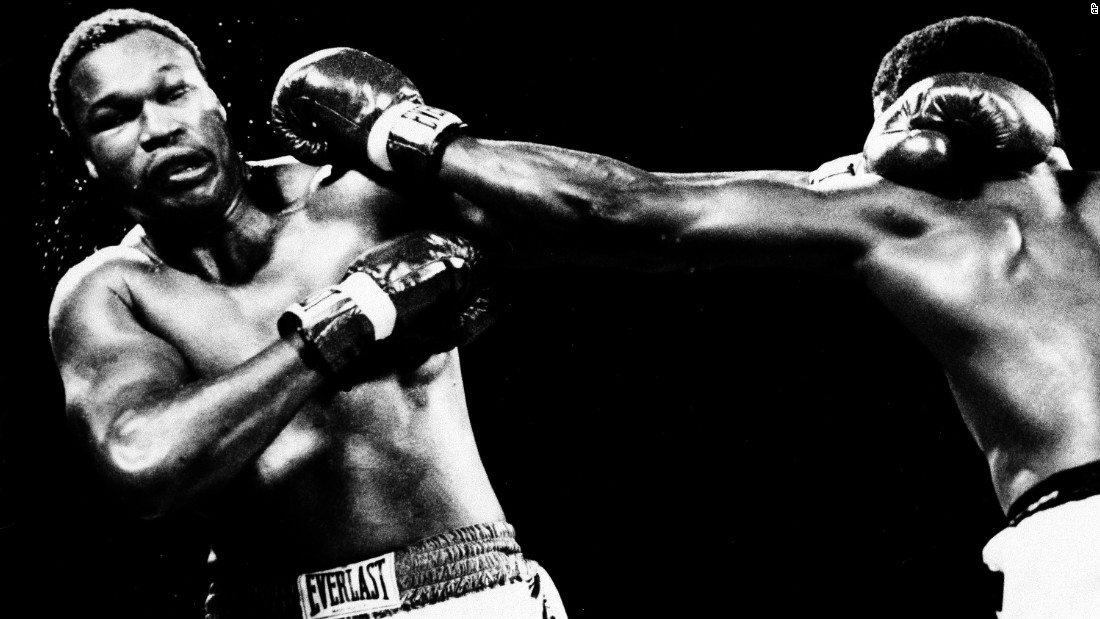 Holmes had won 48 on the spin when he squared up against Michael Spinks. Both were undefeated, both held titles, but as a light heavyweight stepping up a category Spinks was considered the bookies' underdog.<br /><br />Spinks' size disadvantage didn't seem to hamper his performance, and across 15 grueling rounds he outboxed Holmes to a unanimous decision victory (145-142, 145-142, 143-142,) walking away the lineal champion and the first light heavyweight to ever successfully step up a division.<br />