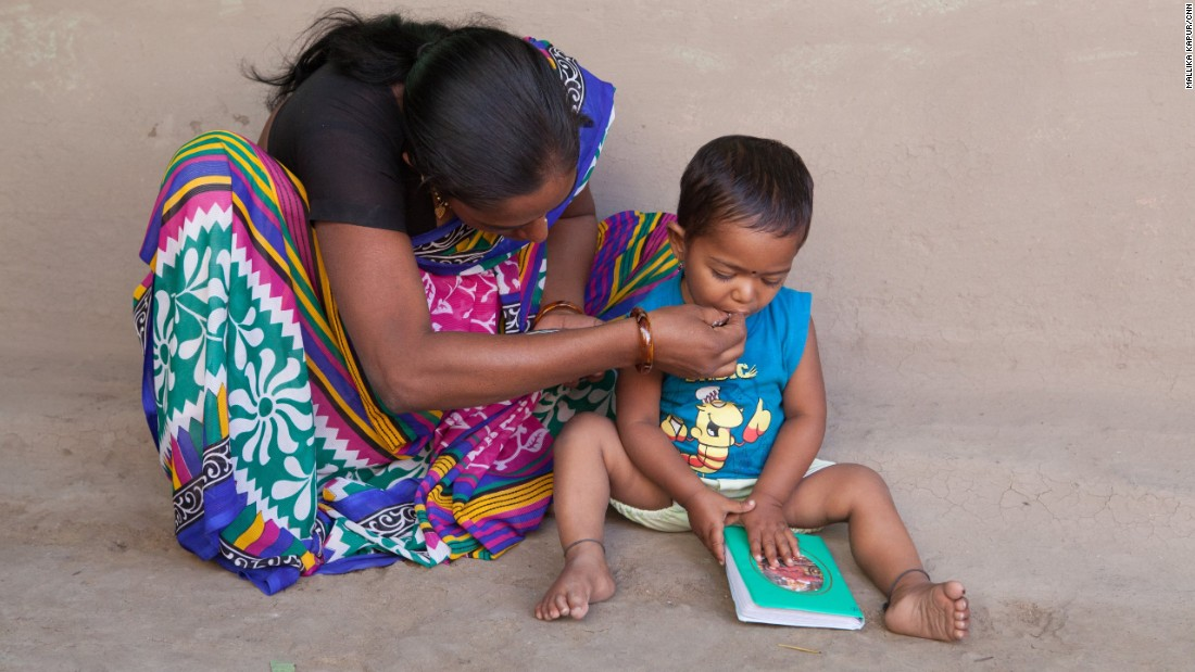 Yogita Kanhaiya feeds her son. He has no idea where his father has gone. She had imagined a very different future for herself and her young family.