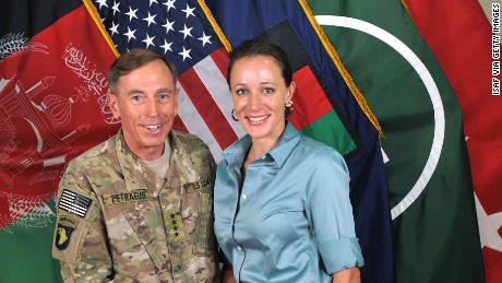 In this handout image provided by the International Security Assistance Force (ISAF), former Commander of International Security Assistance Force and U.S. Forces-Afghanistan; CIA Director Gen. Davis Petraeus, left, shakes hands with biographer Paula Broadwell, co-author of 'All In: The Education of General David Petraeus' on July 13, 2011.