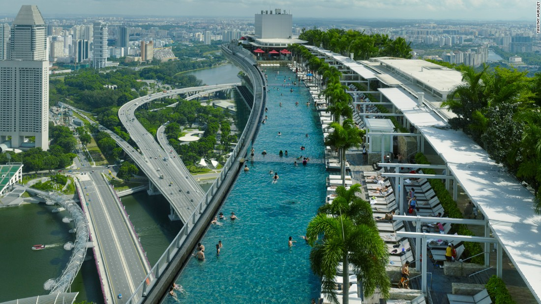 "Marina Bay Sands hotel guests have access to its Infinity pool. Some 200 meters above ground, it's longer than three Olympic-sized swimming pools. Its architect calls it ""the best pool in town."""