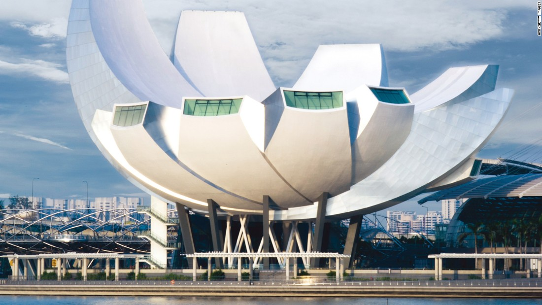 "Singapore's striking ArtScience Museum is part of the Marina Bay Sands complex. Safdie designed it to ""float above the ground."" Some see it as a bunch of bananas, some as a lotus flower and some as a hand of welcome."