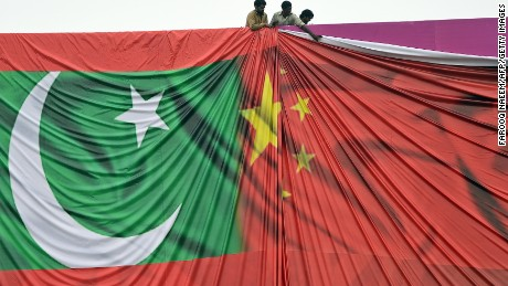 Pakistani labourers arrange a welcome billboard featuring the Chinese and Pakistani national flags ahead of the forthcoming visit by Chinese President Xi Jinping in Islamabad on April 18, 2015. Pakistan needs a 'huge amount of financing' for infrastructure and energy projects and China is ready to announce help when President Xi Jinping visits next week, a foreign ministry official said April 17, 2015.