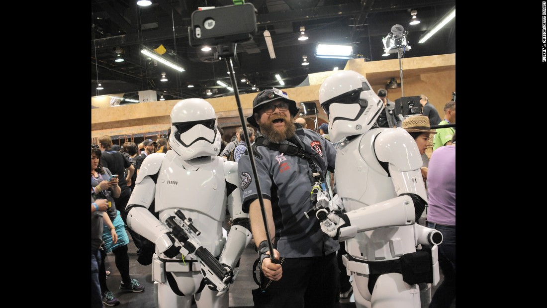 "A man takes a selfie with Stormtroopers during a ""Star Wars"" celebration Thursday, April 16, in Anaheim, California."
