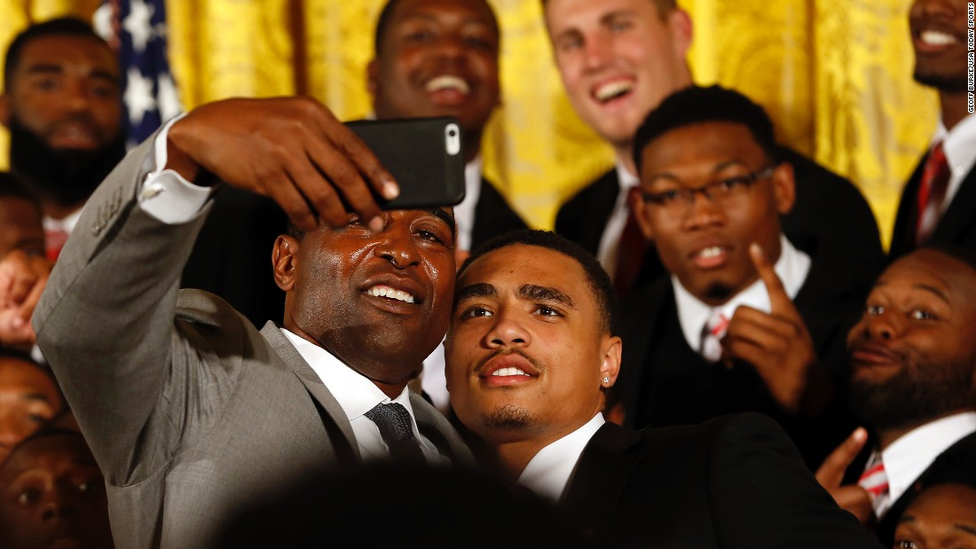 Hall of Fame football player Cris Carter takes a selfie with Ohio State wide receiver Jalin Marshall after a White House ceremony honoring the Buckeyes on Monday, April 20. Carter once played for Ohio State, which won the first-ever college football playoff earlier this year.